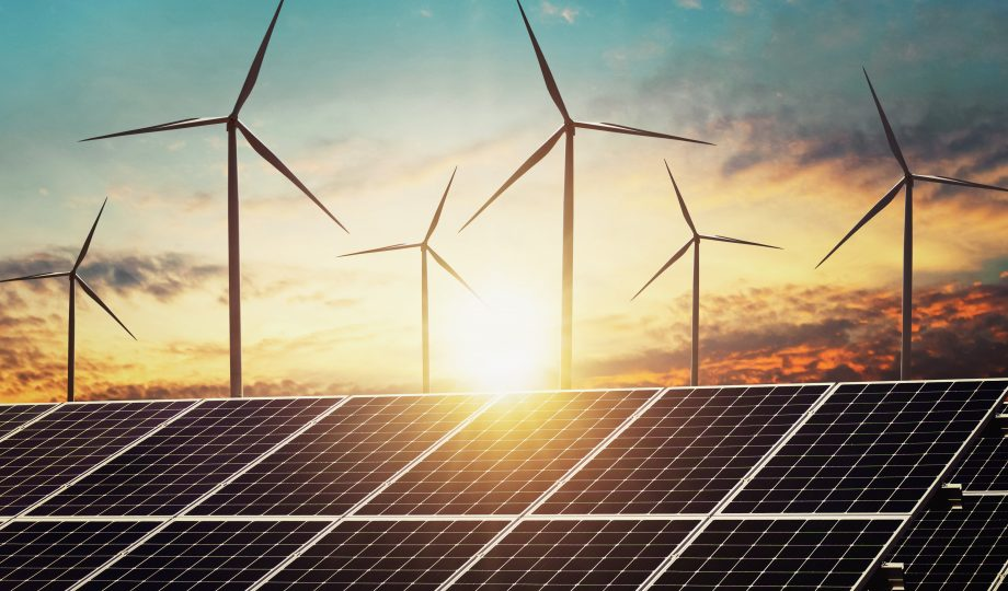 clean energy power concept solar panel with wind turbine and sunset background