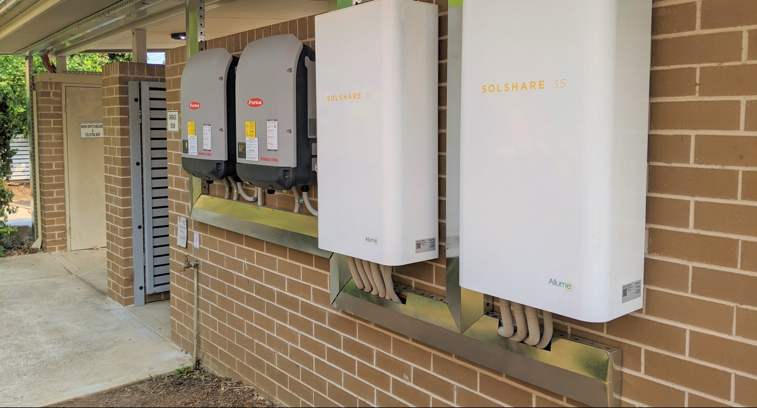 Two SolShares installed next to two Fronius inverters